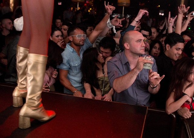 FILE - This Jan. 20, 2013 file photo, revelers dance to the music played by DJ Afrojack inside the XS nightclub in Las Vegas. A poll conducted this year by the national gambling lobby found that 2 ...