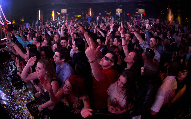 FILE - This Jan. 20, 2013 file photo, revelers dance to the music played by DJ Afrojack inside the XS nightclub in Las Vegas.  A poll conducted this year by the national gambling lobby found that  ...