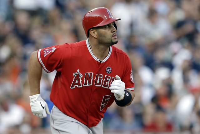 FILE - In this June 26, 2013, file photo, Los Angeles Angels' Albert Pujols watches after batting against the Detroit Tigers in the third inning of a baseball game in Detroit. Pujols sued Jack Cla ...