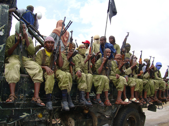 FILE - In this Oct. 30, 2009 file photo, al-Shabab fighters sit on a truck as they patrol in Mogadishu, Somalia. International military forces carried out a pre-dawn strike Saturday, Oct. 5, 2013, ...