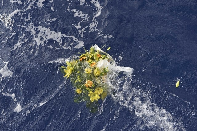 A wreath from the fishermen of Lampedusa is thrown at sea to pay tribute to the victims of Thursday's migrant shipwreck off the coast of the southern Italian island of Lampedusa, Saturday, Oct. 5, ...