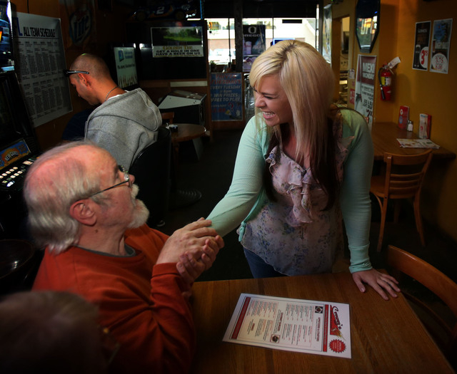 Customer Jerry Arnett, left,  congratulates  Aurora Kephart, a bartender in Springfield, Ore., Friday Oct. 4, 2013 after learning that she indirectly received a $17,500 tip when one of her custome ...