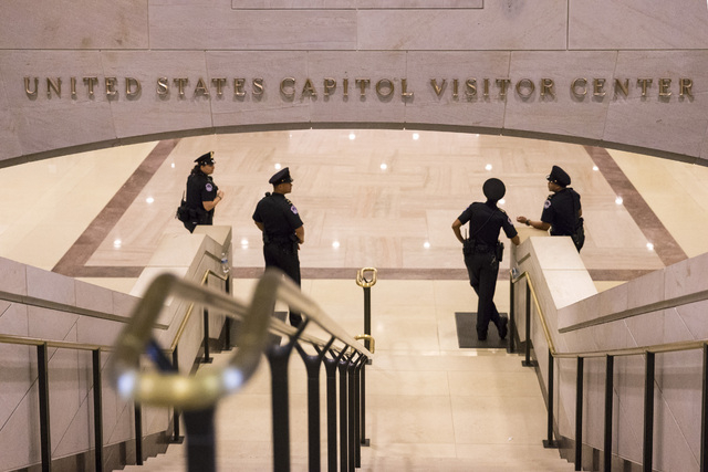 Normally packed with tourists, the stairs leading from the Capitol Visitors Center up to the Capitol Rotunda are empty Monday as the government shutdown enters a second week. The government partia ...