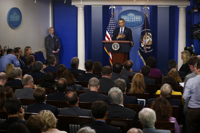 President Barack Obama speaks about the the budget and the partial government shutdown Tuesday in the Brady Press Room of the White House in Washington.  (AP Photo/Charles Dharapak)