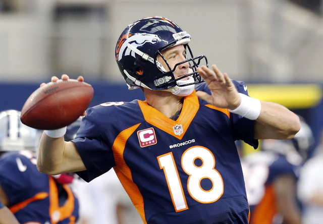 Denver Broncos quarterback Peyton Manning passes the ball against the Dallas Cowboys during the second quarter of an NFL football game Sunday, Oct. 6, 2013, in Arlington, Texas. (AP Photo/Sharon E ...