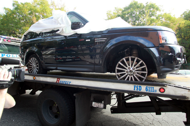 The Range Rover involved in the bikers attack is being moved from the police precinct for further police investigation Saturday, Oct. 5, 2013 in New York.  Last weekend, dozens of bikers stopped t ...