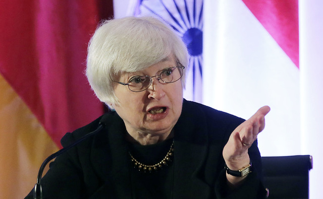 FILE - In this Monday, June 3, 2013, file photo, Janet Yellen, vice chair of the Board of Governors of the Federal Reserve System, answers a question from a participant at the International Moneta ...
