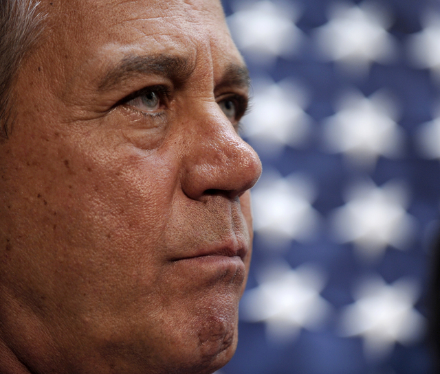 House Speaker John Boehner of Ohio listens during a news conference on Capitol Hill in Washington, Thursday, Oct. 10, 2013, following a meeting with House Republicans. Boehner said  Republicans wi ...