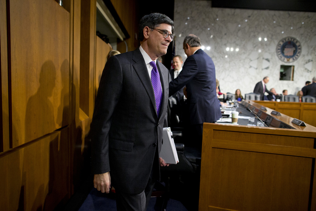 Treasury Secretary Jacob Lew arrives on Capitol Hill in Washington, Thursday, Oct. 10, 2013, to testify before the Senate Finance Committee to urge Congress to reopen the government and lift the U ...