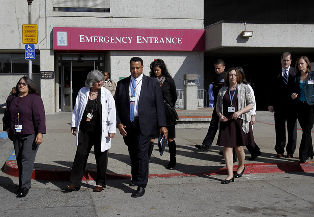 San Francisco General Hospital staff walk to a media conference at the hospital Tuesday, Oct. 9, 2013 in San Francisco. Officials confirmed the identity of a woman's body that had been discovered  ...