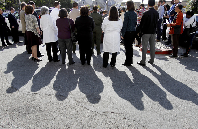 San Francisco General Hospital staff attend a media conference at the hospital Tuesday, Oct. 9, 2013 in San Francisco. Officials confirmed the identity of a woman's body that had been discovered i ...