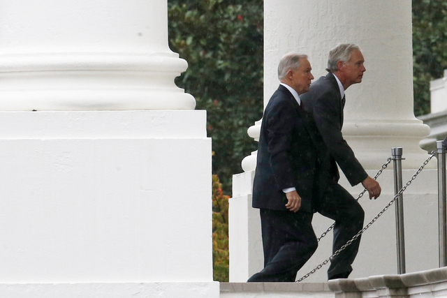 Sen. Ron Johnson, R-Wis., right, and Sen. Jeff Sessions, R-Ala., arrive with other Republican senators at the North Portico of the White House in Washington, Friday, Oct. 11, 2013, to meet with Pr ...