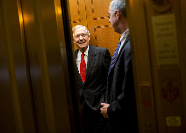 Senate Minority Leader Mitch McConnell of Ky. gets on an elevator to leave Capitol Hill in Washington, Friday, Oct. 11, 2013, for a meeting with President Obama at the White House. After weeks of  ...