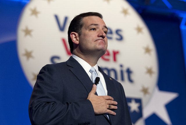 Sen. Ted Cruz R-Texas pauses while speaking at the Values Voter Summit, held by the Family Research Council Action, Friday, Oct. 11, 2013, in Washington. Afterward, Cruz went to the White House fo ...