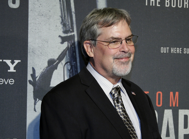"In this Oct. 2, 2013, photo, Captain Richard Phillips, walks the red carpet at a screening for the movie ""Captain Phillips"" at the Newseum in Washington. Dramatic accounts of the Navy SE ..."