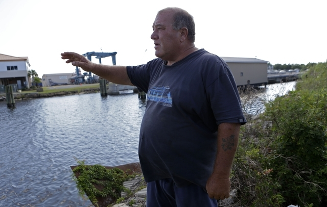 In this Wednesday, Oct. 9, 2013 photo, Calvin Parker, Jr., stands in the area where he and fellow Mississippian Charles Hickson were allegedly abducted by aliens on Oct. 11,1973, on the banks of t ...
