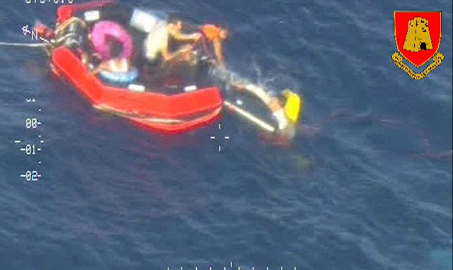 In this video image made available by the Armed Forces of Malta from an overflying aircraft, a life raft carrying survivors  floats in the sea between Malta and the Italian island of Lampedusa, Fr ...