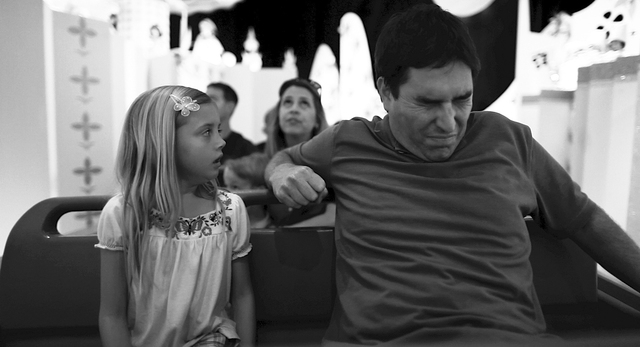 """This undated photo released by Mankurt Media, LLC shows Roy Abramsohn as Jim freaking out during a ride in the amusement park on the last day of his family vacation in a scene from """"Escape fr ..."""