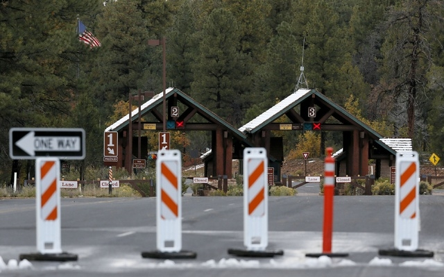 The main entrance to Grand Canyon National Park remains closed to visitors on Thursday Oct. 10, 2013, in Grand Canyon, Ariz. Under pressure from several governors, the Obama administration said Th ...