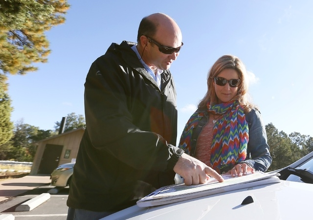 Rassie Erasmus, left, and his wife Yolanda Erasmus, of Cape Town, South Africa, look at a map to plan their next drive in an attempt to see the Grand Canyon, as the main entrance to Grand Canyon N ...