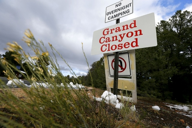 The main entrance to Grand Canyon National Park remains closed to visitors on Thursday Oct. 10, 2013, in Grand Canyon, Ariz.  Under pressure from several governors, the Obama administration said T ...