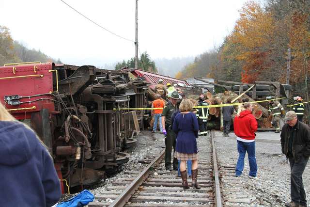 Crews work at the site where a truck carrying logs down crashed into the side of the train taking passengers on a scenic tour in rural Randolph County, W.Va., on Friday. The crash killed one perso ...