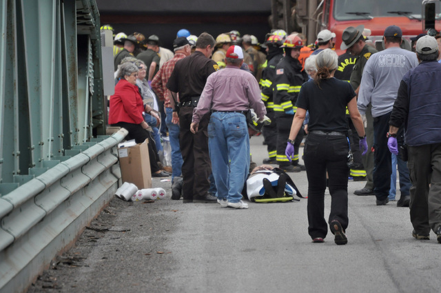 Emergency personnel tend passengers who were injured in a crash involving a truck carrying logs down Cheat Mountain on U.S. Route 250 and train taking passengers on a scenic tour in rural Randolph ...
