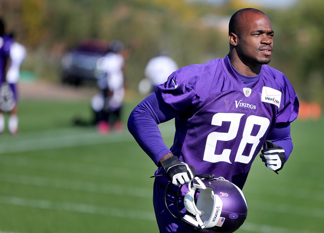 Minnesota Vikings' Adrian Peterson makes his way off an NFL football practice field at Winter Park in Eden Prairie, Minn., Friday, Oct. 11, 2013. Peterson said he is certain he will play Sunday de ...