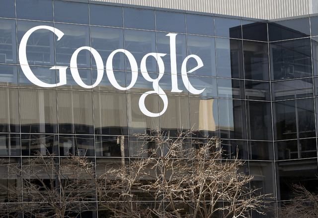 This Jan. 3, 2013 file photo shows a Google sign at the company's headquarters in Mountain View, Calif. Google wants your permission to use your name, photo and product reviews in ads that it sell ...