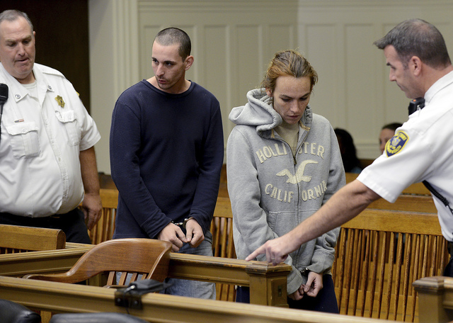 Ryan J. Barry,  second from left, and Ashley Cyr, second from right, are led into Brockton, Mass., Superior Court for arraignment Friday, Oct. 11, 2013, on charges of manslaughter in the death of  ...