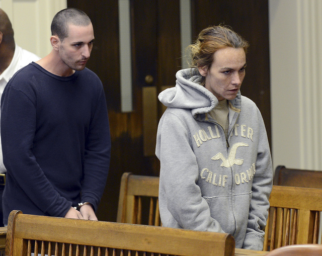 Ryan J. Barry, left, and Ashley Cyr, right, are led into Brockton, Mass., Superior Court for arraignment Friday, Oct. 11, 2013, on charges of manslaughter in the death of their 5-month-old daughte ...