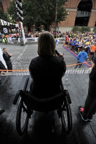 Boston marathon bombing survivor Erika Brannock speaks to runners before the start of the Baltimore marathon Saturday, Oct. 12, 2013 in Baltimore.(AP Photo/Gail Burton)