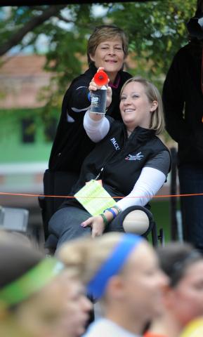 Boston marathon bombing survivor Erika Brannock, front, and her mom Carol Downing blow an air horn to start the Baltimore marathon Saturday, Oct. 12, 2013 in Baltimore.(AP Photo/Gail Burton)