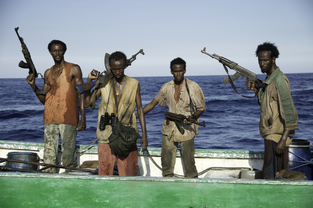 """This photo released by Sony - Columbia Pictures shows, from left, Faysal Ahmed, Barkhad Abdi, Barkhad Abdirahman, Mahat Ali, in a scene from the film, """"Captain Phillips,"""" releasing in th ..."""