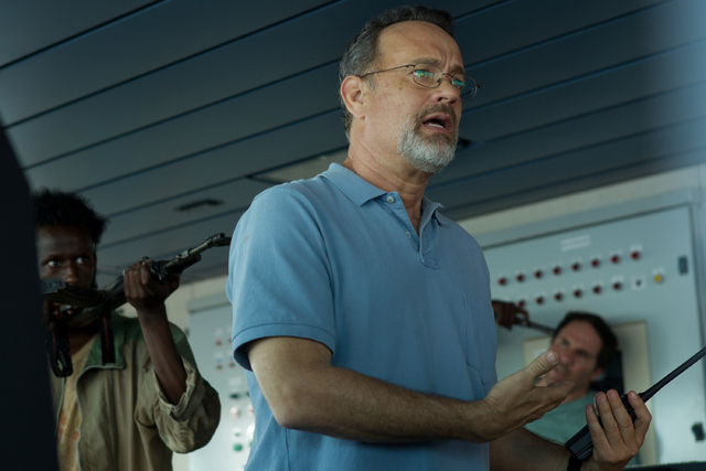 """This photo released by Sony - Columbia Pictures shows actor Tom Hanks in a scene from the film, """"Captain Phillips,"""" releasing in the US on Friday, Oct. 11, 2013. Some amateur actors from ..."""