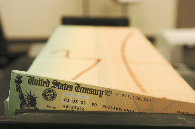 In this Feb. 11, 2005 file photo, trays of printed social security checks wait to be mailed from the U.S. Treasury's Financial Management services facility in Philadelphia.  For the second straigh ...