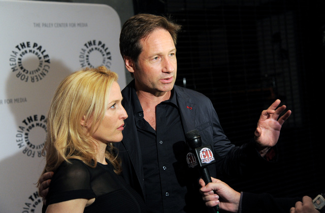 """Actors Gillian Anderson and David Duchovny attend """"The Truth Is Here: David Duchovny and Gillian Anderson on The X-Files"""" at The Paley Center for Media on Saturday, Oct. 12, 2013 in New  ..."""