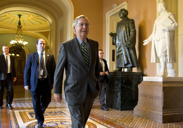 Senate Minority Leader Sen. Mitch McConnell, R-Ken., walks to his office after arriving on Capitol Hill on Monday, Oct. 14, 2013 in Washington. The federal government remains partially shut down a ...