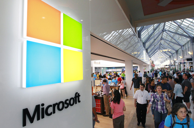 Microsoft is updating its Windows software for cellphones to accommodate larger devices and make it easier for motorists to reduce distractions while driving. (AP Photo/Steven Senne, File)