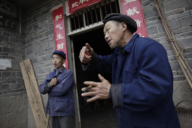 Zhou Mingde, right, and Zhou Yinxi, sons of Zhang Zefang, a 94-year-old woman who sued her own children for not taking care of her, speak in Fusheng Village, east of Chongqing City, China on March ...