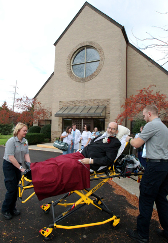 In this Oct. 12, 2013 photo, Scott Nagy is wheeled from First Lutheran Church in Strongsville by paramedics Melissa Powell, left, and Andrew Gorman, right, to a spot in the parking lot so he could ...