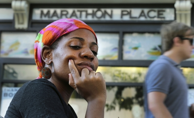 Mery Daniel, a Boston Marathon bombing survivor, pauses on Boylston Street in Boston on May 31 while visiting the explosion site where she lost most of her left leg. Six weeks earlier, the Haitian ...