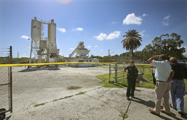 Polk County sheriff personnel investigate the death of 12-year-old Rebecca Ann Sedwick on Sept. 21 at an old cement plant in Lakeland, Fla. Officials say Rebecca committed suicide after being bull ...