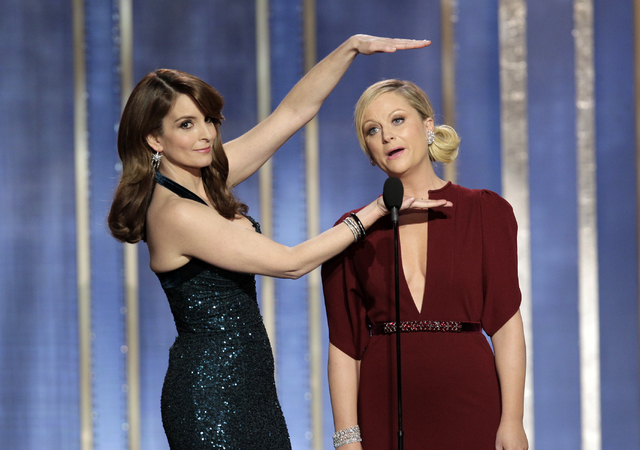 Co-hosts Tina Fey, left, and Amy Poehler appear on stage during the annual Golden Globe Awards in January. The Hollywood Foreign Press Association said Tuesday that Fey and Poehler have signed up  ...
