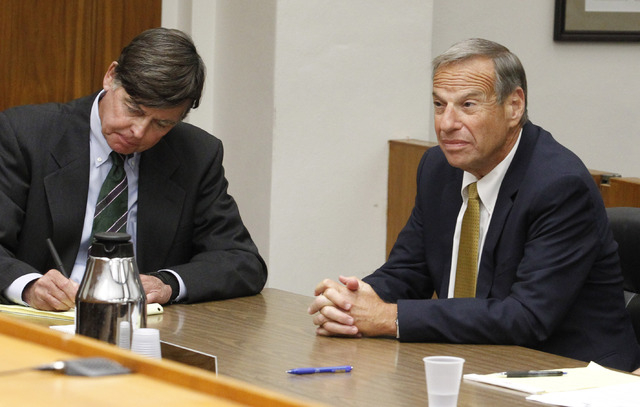 Former San Diego Mayor Bob Filner, right, sits with counsel in court Tuesday before he pleads guilty on state charges of felony false imprisonment in San Diego. Filner pleaded guilty to one crimin ...