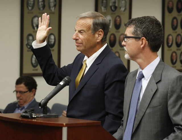 Former San Diego Mayor Bob Filner stands with counsel in court and takes an oath before he pleads guilty on state charges of felony false imprisonment on Tuesday. (AP Photo/UT-San Diego, John Gibbins)
