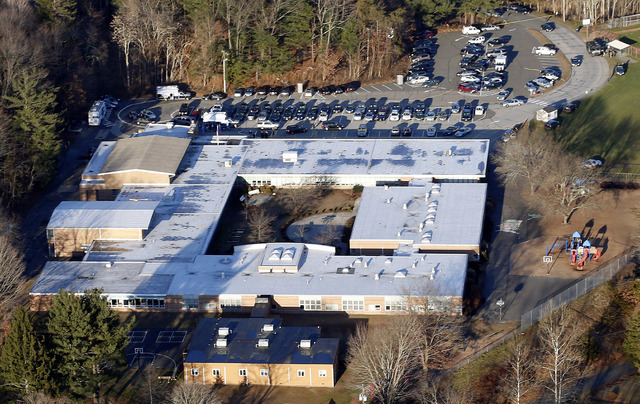 This Dec. 14, 2012 aerial file photo shows Sandy Hook Elementary School in Newtown, Conn. Contractors demolishing Sandy Hook Elementary School are being required to sign confidentiality agreements ...