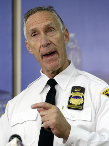 Cleveland Police Chief Michael McGrath announces the results of disciplinary hearings for officers involved in a deadly chase Tuesday, Oct. 15, 2013, in Cleveland. McGrath said 63 officers have be ...
