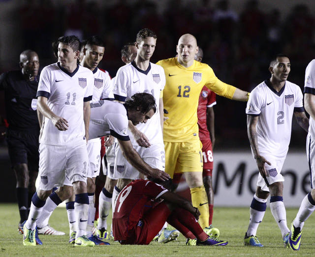 Graham Zusi of the U.S. reaches out to a dejected Alberto Quintero of Panama after the U.S. defeated Panama in a 2014 World Cup qualifying soccer match in Panama City, Tuesday, Oct. 15, 2013. The  ...