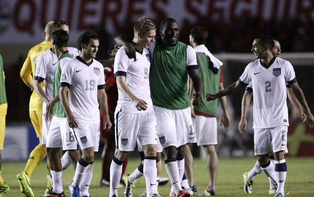 Members of the U.S. national soccer team leave the pitch after defeating Panama in a 2014 World Cup qualifying soccer match in Panama City, Tuesday, Oct. 15, 2013. The United States rallied for a  ...